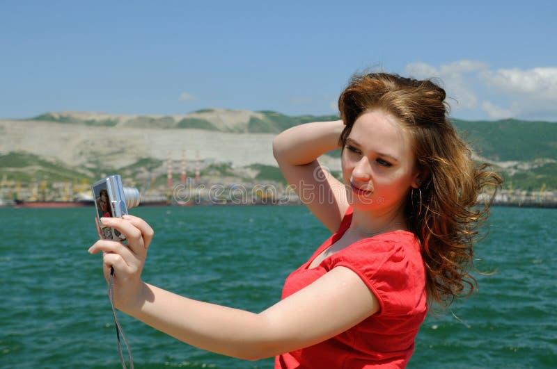 The Girl Photographes Itself Royalty Free Stock Photos