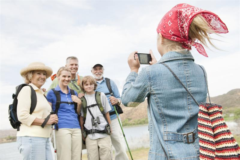 Girl Photographing Family Portrait stock photos