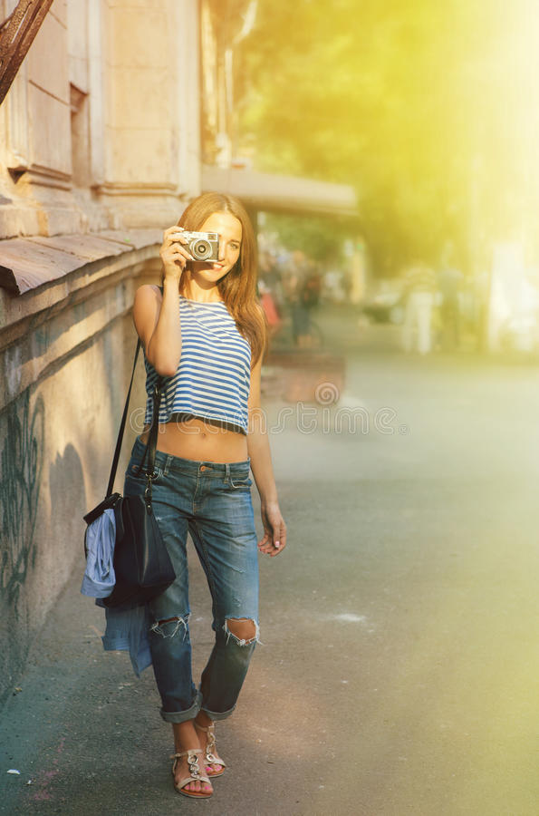 Girl photographing on the old europe street. Girl photographing on the europe street stock image