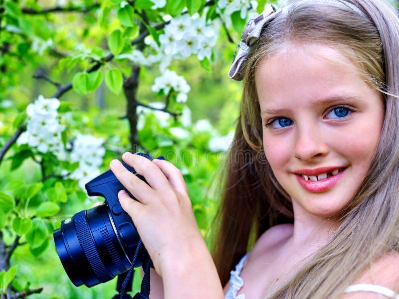 Girl photographs blossoming tree royalty free stock photo