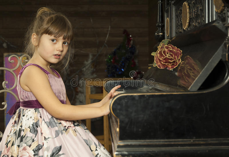 Girl and piano with flower royalty free stock photo