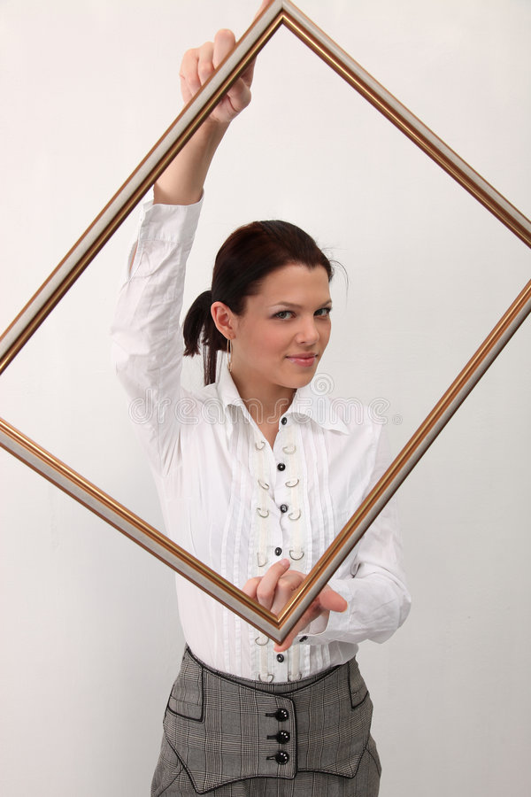 Girl with picture frame stock photography