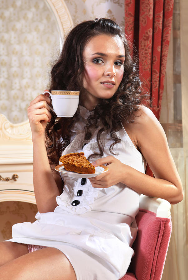 Girl with piece of cake royalty free stock images