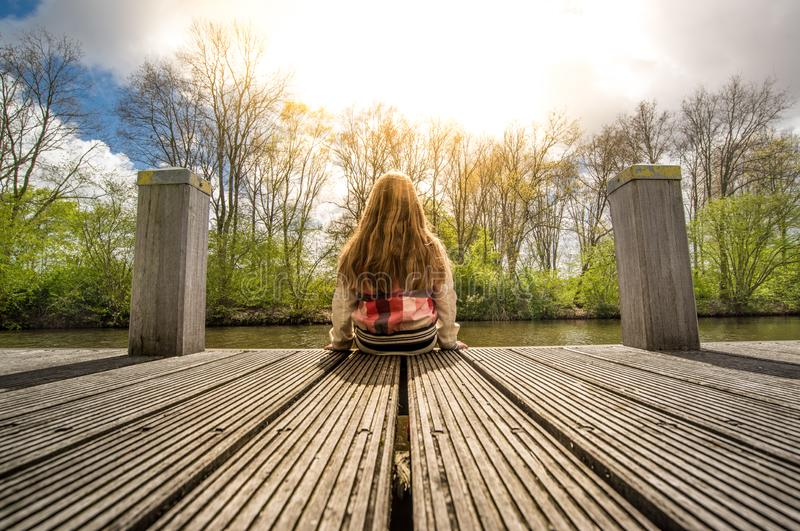 Girl on pier royalty free stock photo