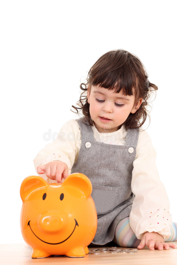 Girl and piggy bank royalty free stock photography