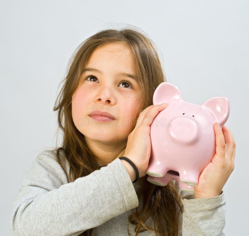 Girl piggy bank stock images