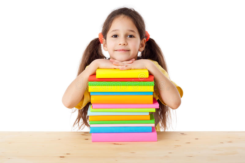 Girl with pile of books stock photos
