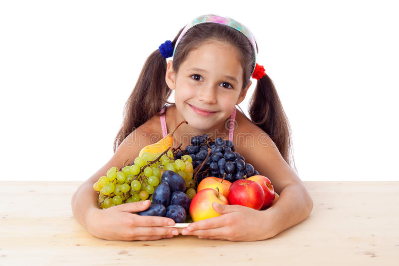Girl with pile of fruit royalty free stock photo
