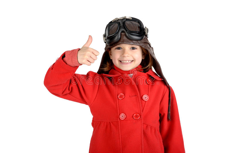 Girl pilot. Young girl with pilot goggles and hat isolated in white royalty free stock images