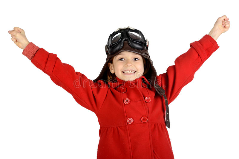 Girl pilot. Young girl with pilot goggles and hat isolated in white stock images