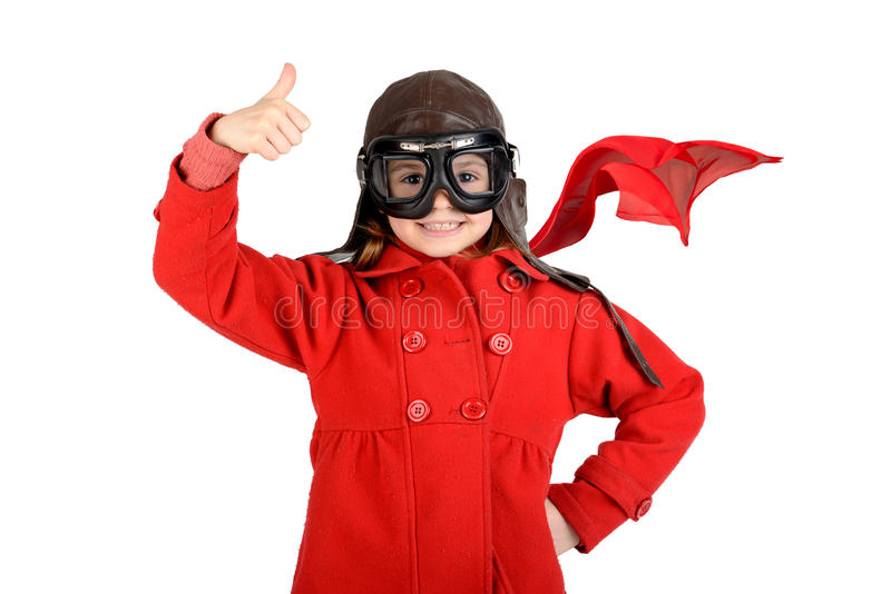 Girl pilot. Young girl with pilot goggles and hat isolated in white royalty free stock photo