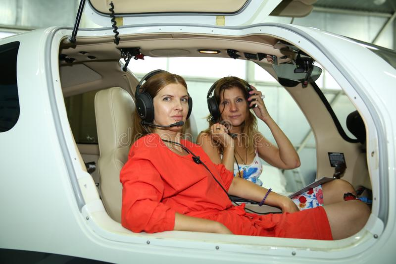 Girl pilots are ready to fly stock images
