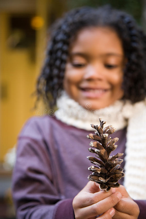 Girl with a pine cone royalty free stock photos