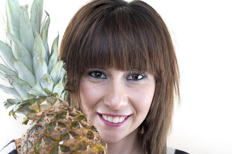 Girl with pineapple. isolated female head portrait on white back. Ground stock photo