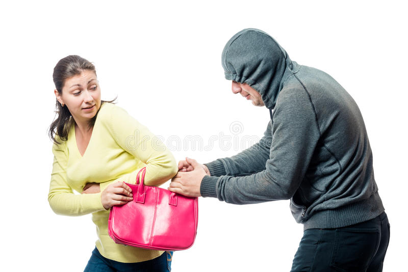 Girl with a pink bag became a victim of a robber. A portrait on a white background stock photo