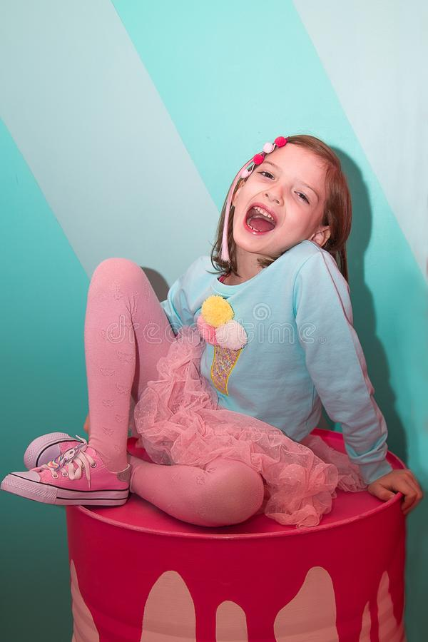 Girl in pink clothes in the Museum of sweets royalty free stock photos