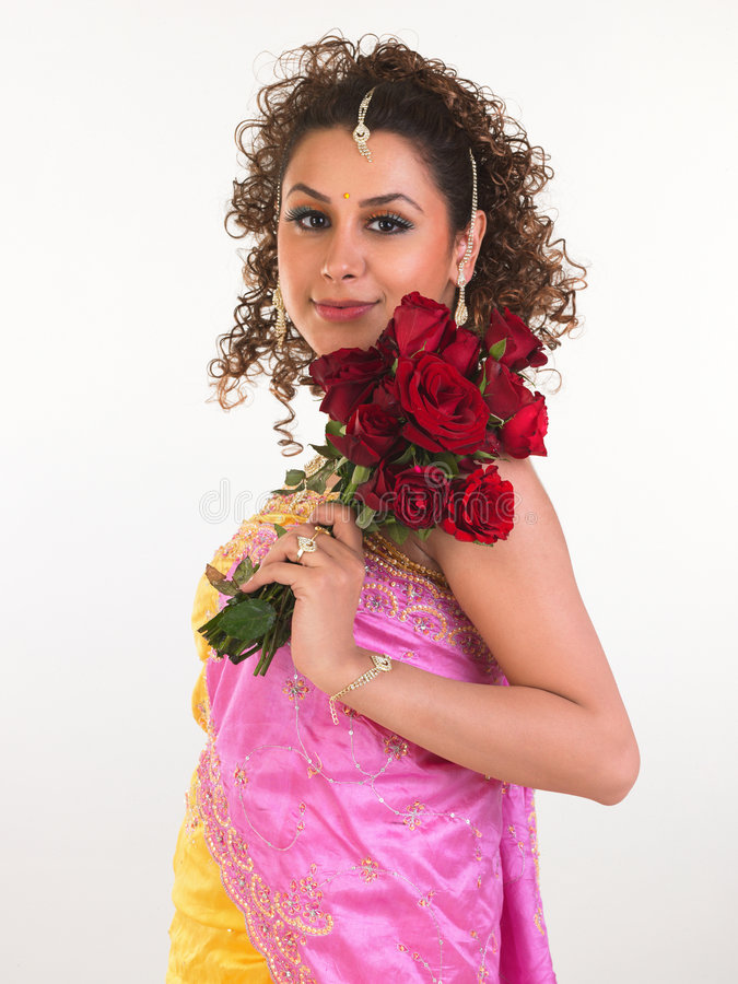 Download Girl In Pink Dress Holding Roses Stock Photo - Image: 8121828