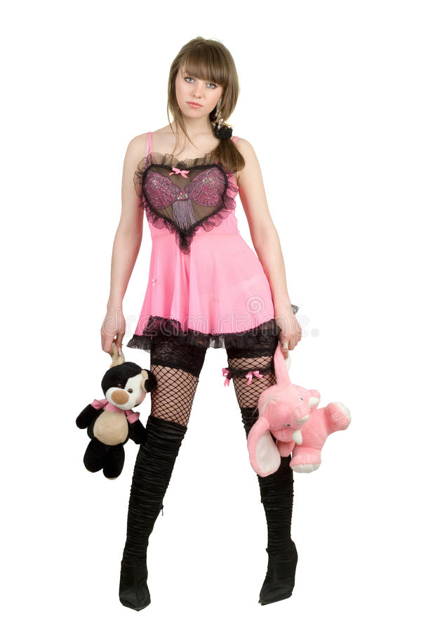 Girl in a pink dress with plush toys royalty free stock images