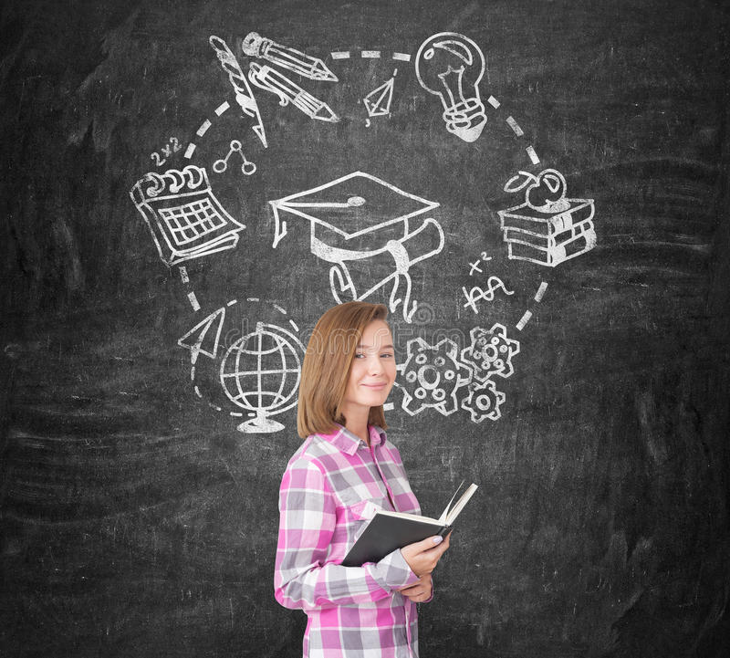 Girl in pink and education, blackboard stock photos