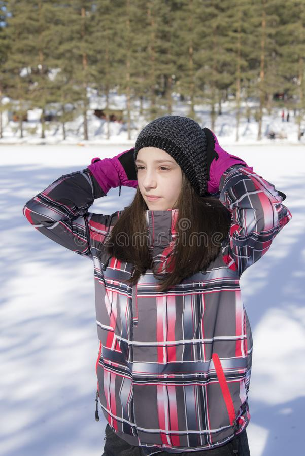Girl with pink gloves. Outdoor royalty free stock photos