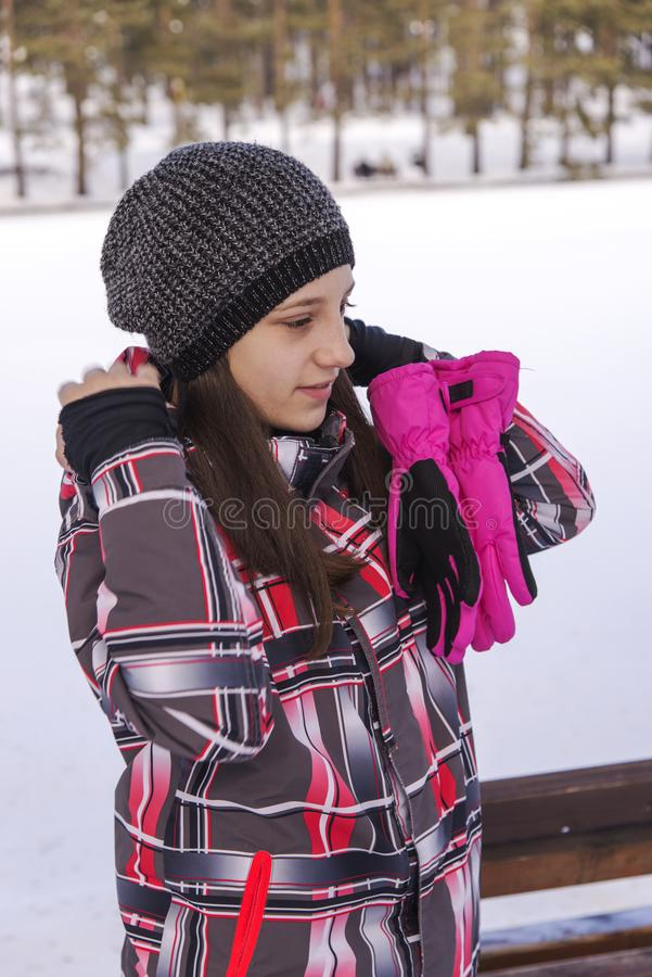 Girl with pink gloves. Outdoor stock photos