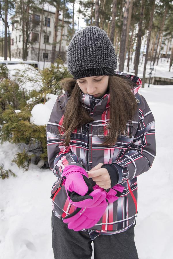 Girl with pink gloves. Outdoor royalty free stock photo