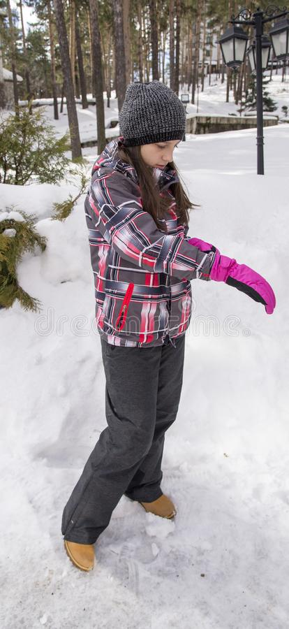 Girl with pink gloves. Outdoor royalty free stock image