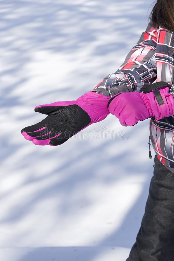 Girl with pink gloves. Outdoor stock images