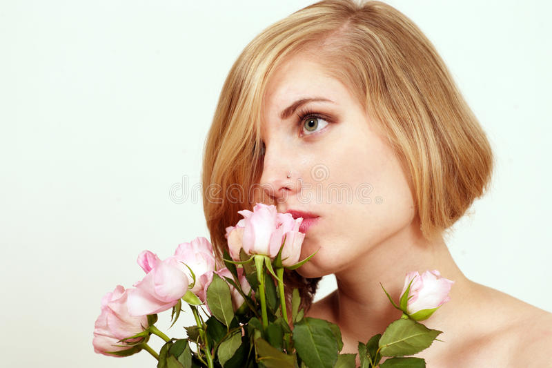 Girl with pink roses royalty free stock image
