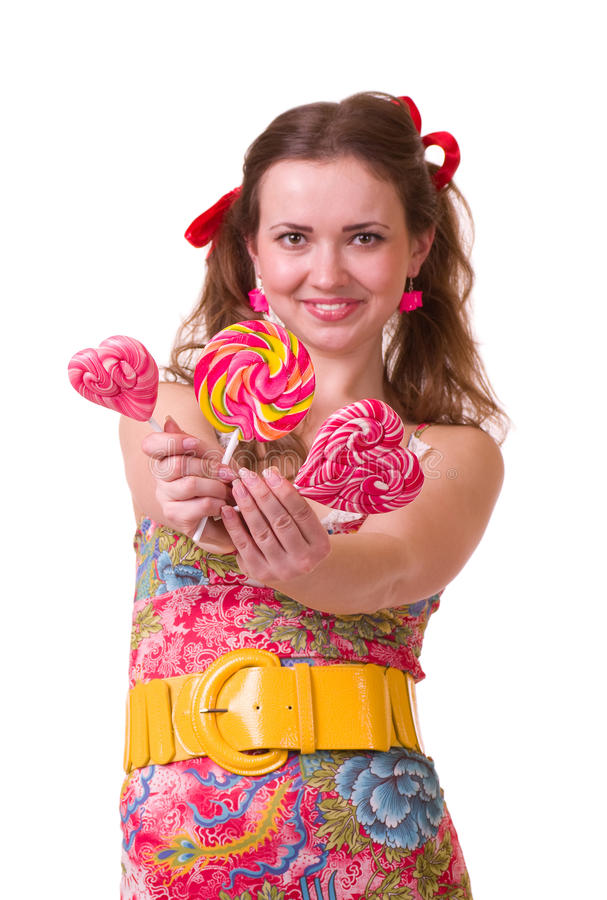 Download Girl With Pink Spiral Lollipops Stock Photo - Image: 22619430