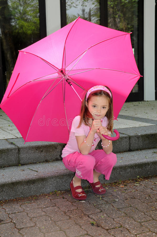 Download Girl with pink umbrella stock photo. Image of parasols - 24575676