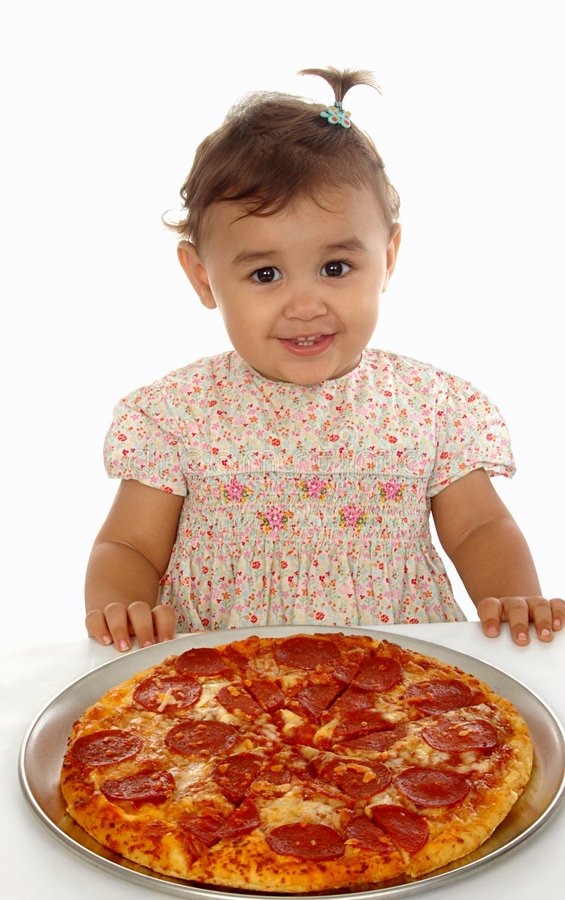 Girl and pizza 15 months old royalty free stock photography