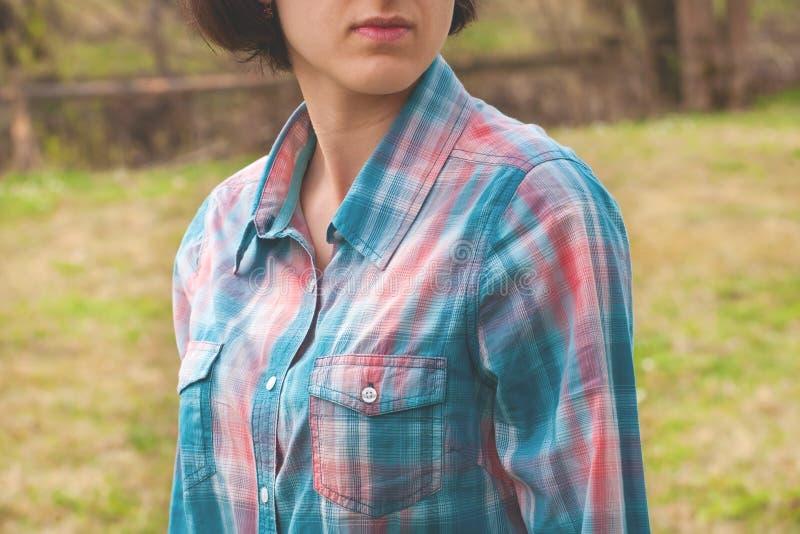 Girl in plaid shirt. stock photos