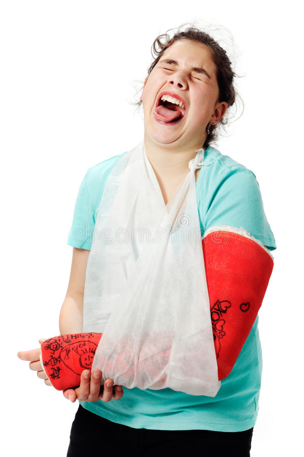 Girl with plaster cast and sling stock image