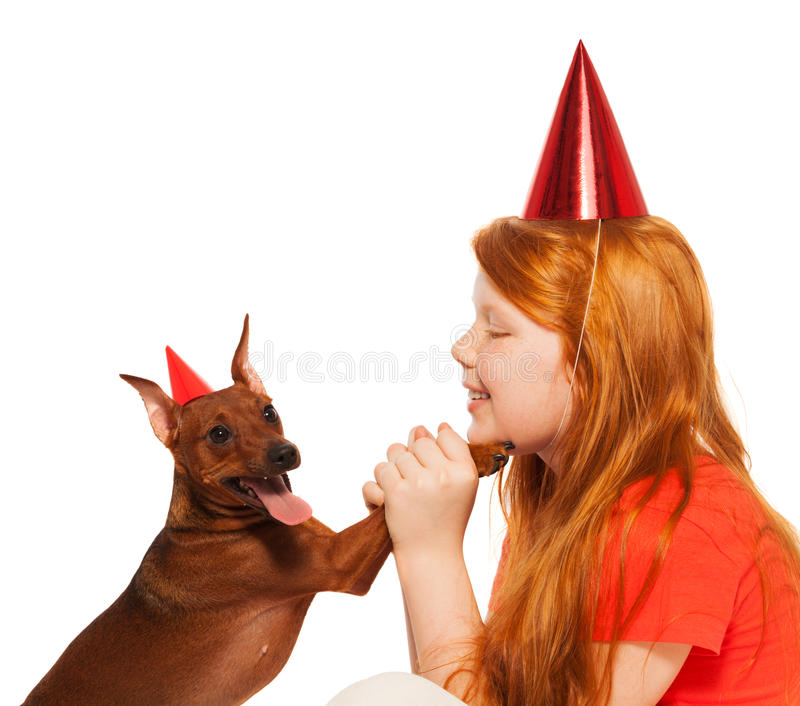 Girl play birthday party for pet dog royalty free stock images