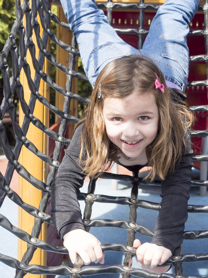 Girl at the playground stock photography
