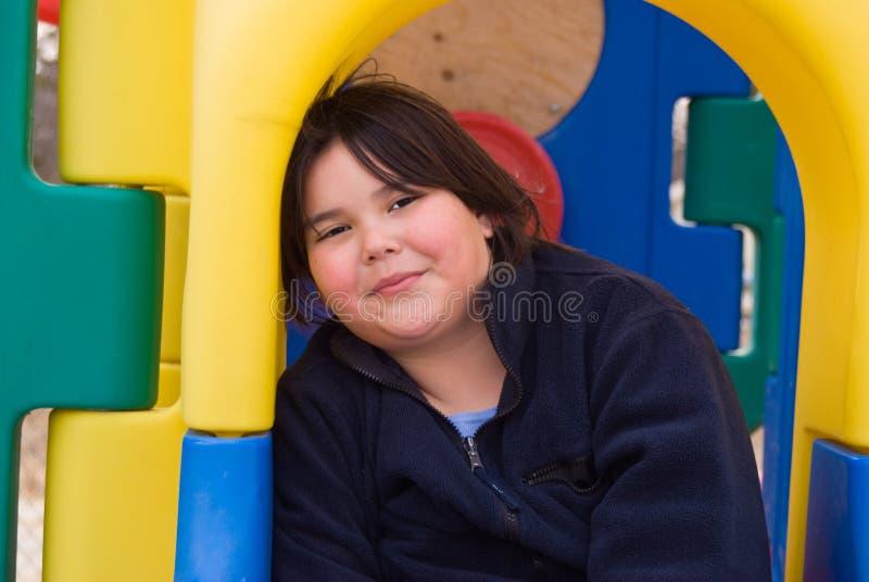 Girl In Playground Equipment stock image