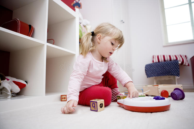 Girl playing royalty free stock images