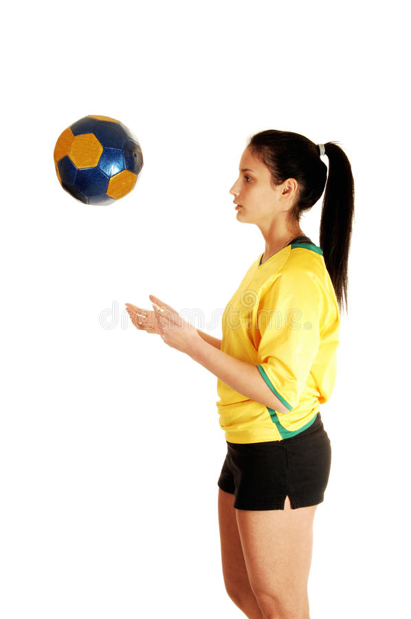 Girl playing with ball.