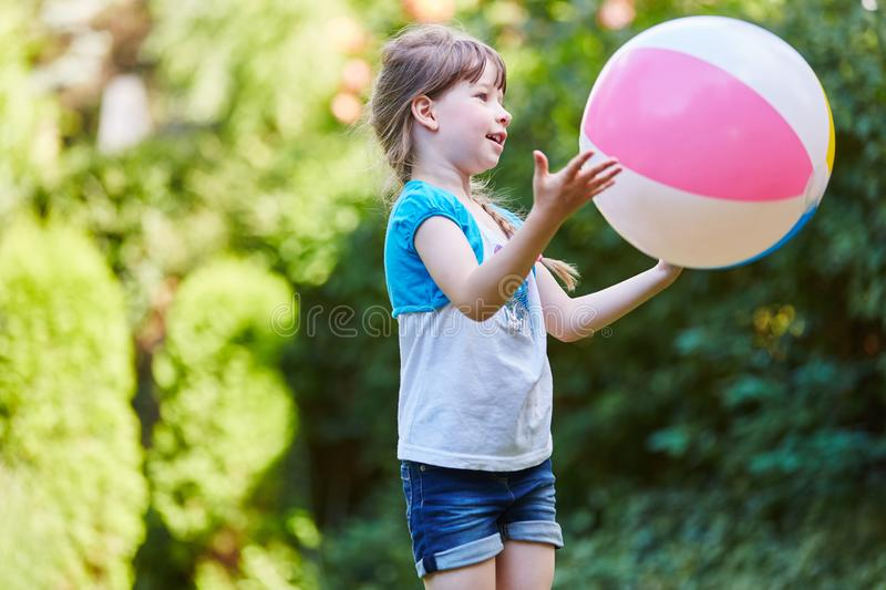 Girl playing ball game in the park stock photo