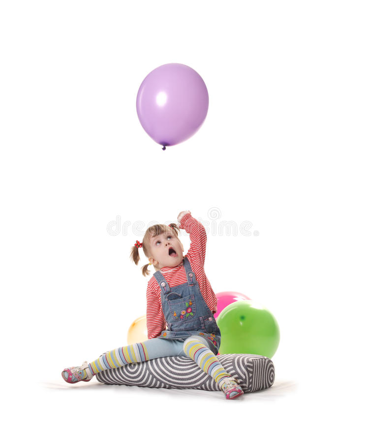 Girl playing with balloon stock photos