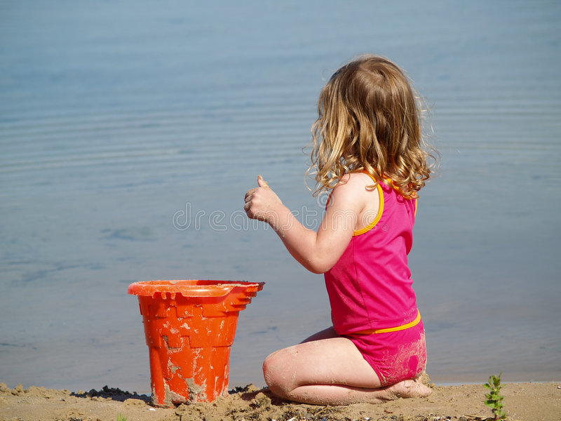 Girl playing at beach stock photo