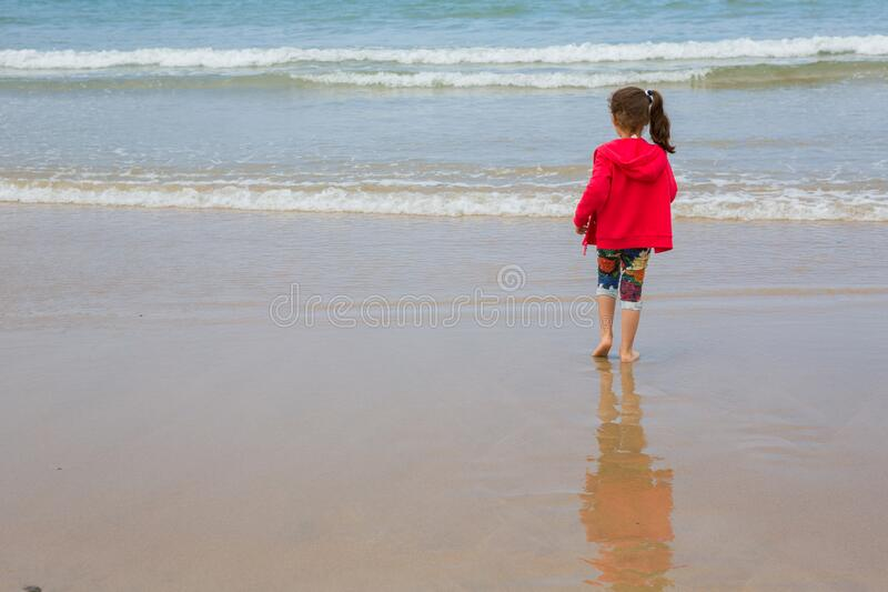 Girl playing at the beach royalty free stock photography