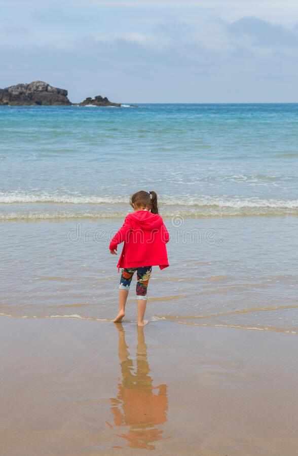 Girl playing at the beach stock photography
