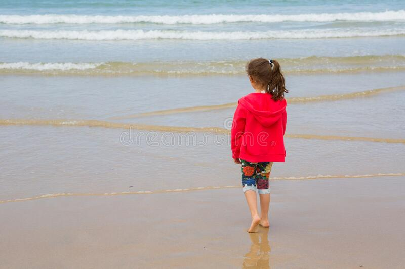 Girl playing at the beach royalty free stock photo