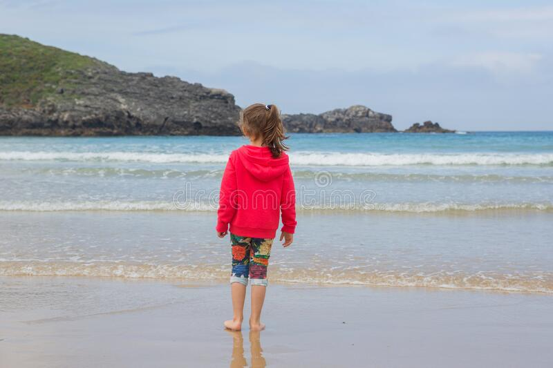 Girl playing at the beach stock image