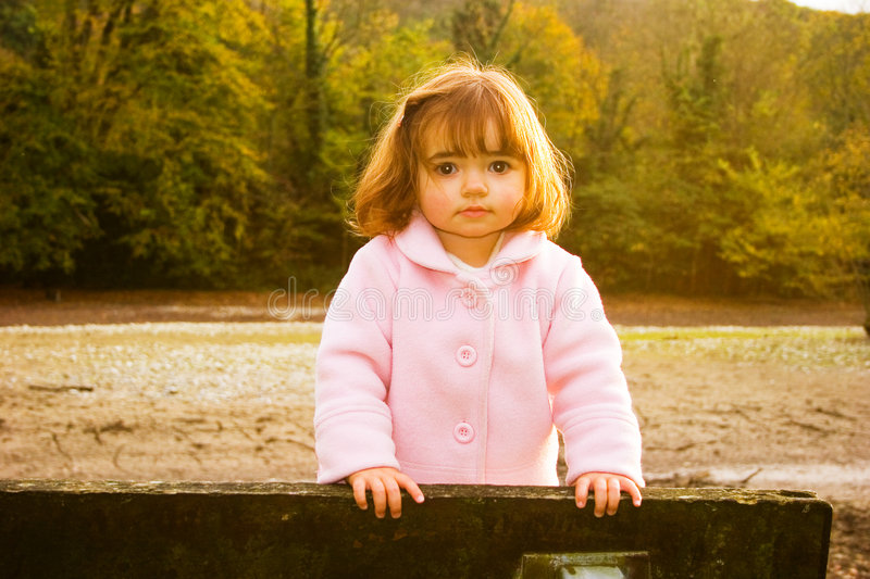 Girl playing on bench royalty free stock photos