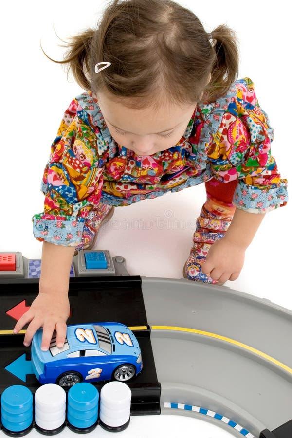 Girl playing with car stock photos