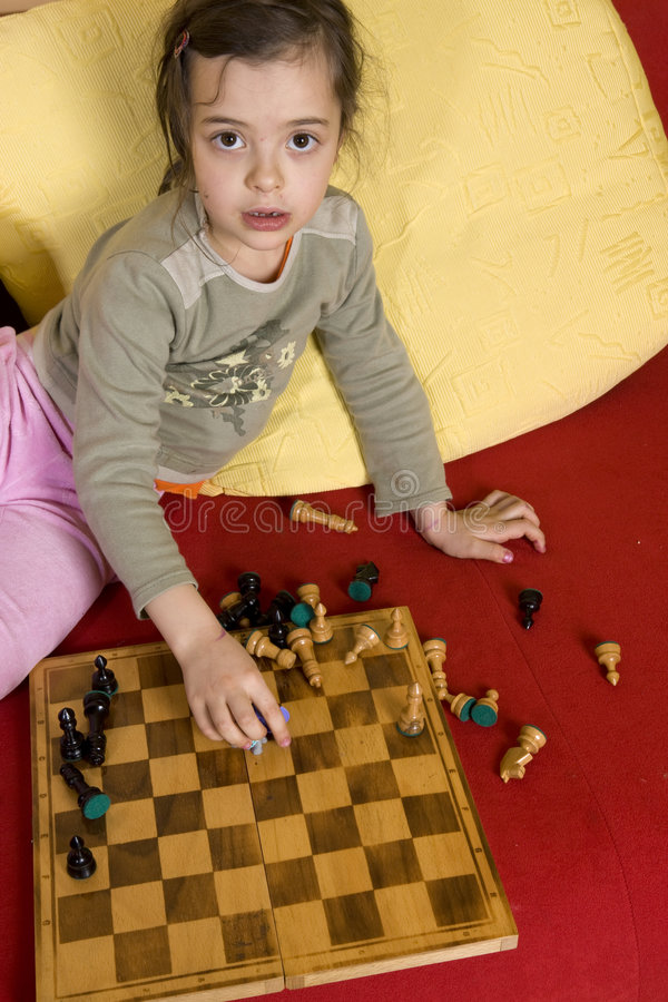 Girl playing the chess. Young girl playing the chess stock photos