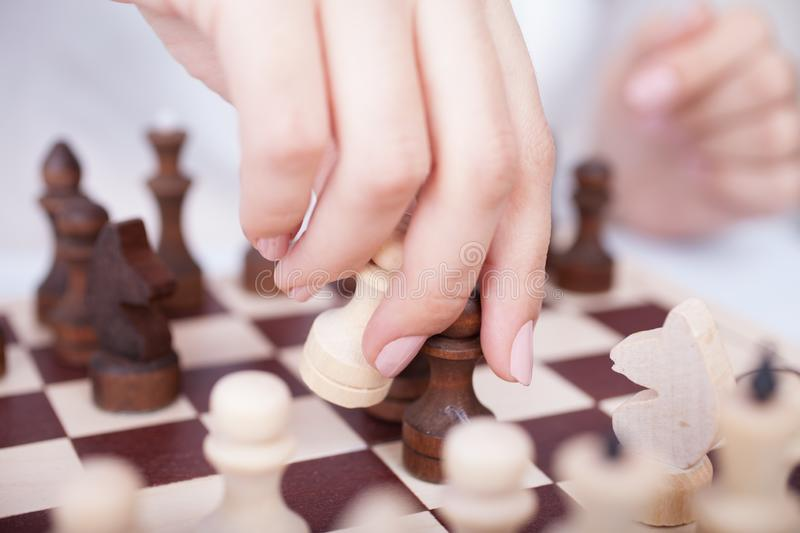 Girl playing chess royalty free stock images